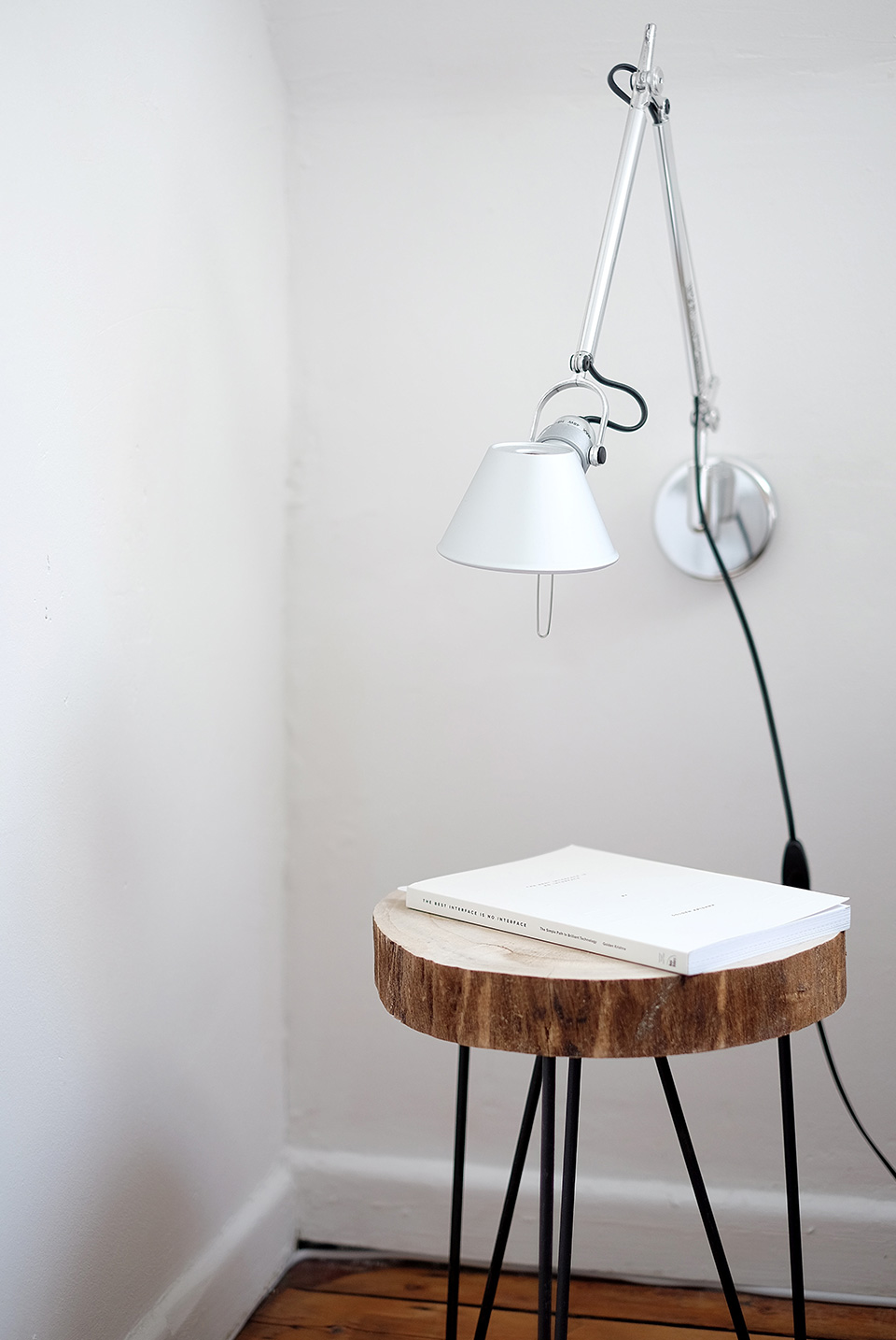 A stool with a book on top